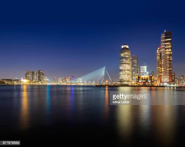 cityscape with skyscrapers at night, rotterdam, holland - rotterdam stock-fotos und bilder