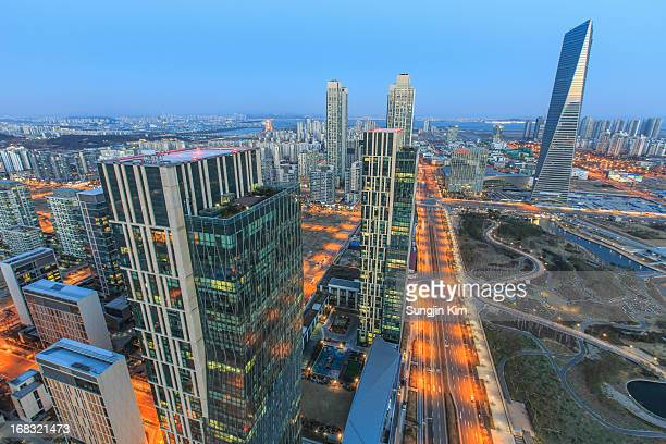 cityscape with skyscrapers - songdo ibd stock pictures, royalty-free photos & images