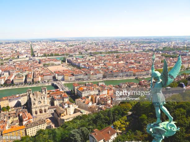 cityscape with statue of angel, lyon, france - auvergne rhône alpes stock pictures, royalty-free photos & images