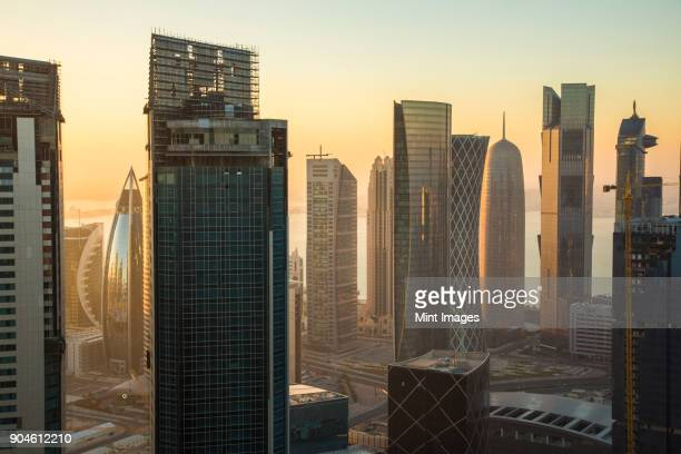 cityscape with tall modern skyscrapers at dusk. - doha stockfoto's en -beelden