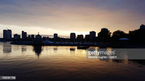 Cityscape With Waterfront At Sunset