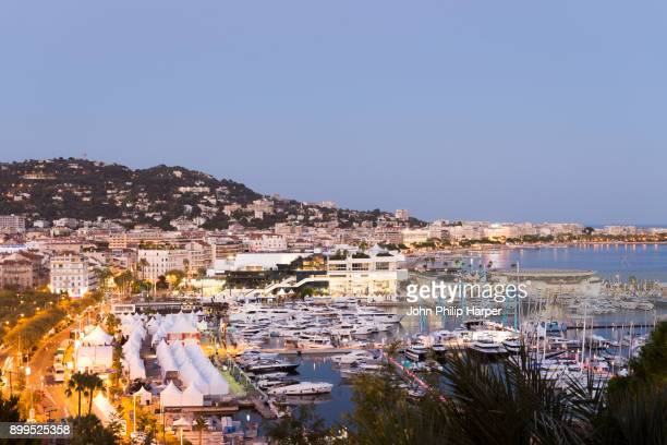Cityscape with waterfront hotels and marina at dusk, Cannes, Cote dAzur, France