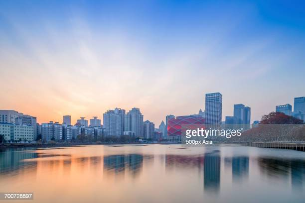 cityscape at sunset - wuhan stock photos and pictures