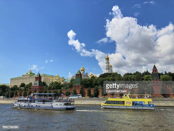 Cityview from river Moskva with river sightseeing boats Kremlin and Saint Basil's Cathedral at Red Square on July 05 2018 in Moscow Russia