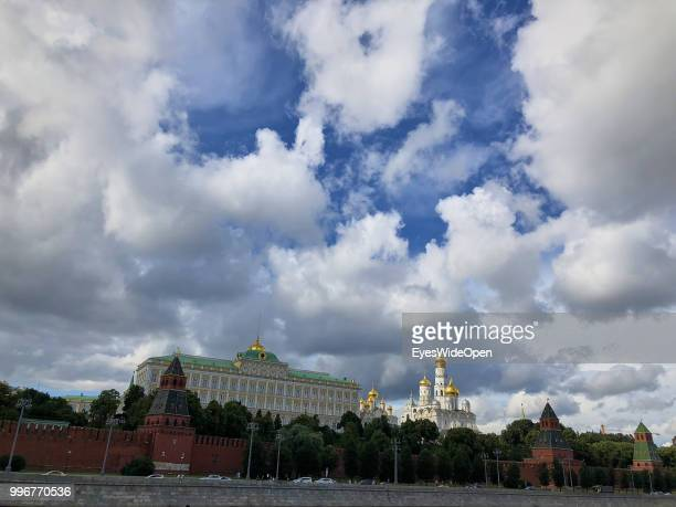 Cityview from river Moskva with river sightseeing boats Kremlin and Saint Basil's Cathedral at Red Square on July 9 2018 in Moscow Russia