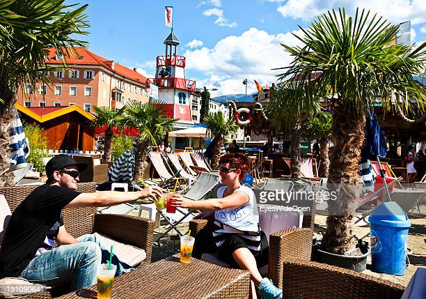 Cityview with traditional houses beach bar with palm trees market and traditional food on August 17 2011 in Innsbruck Austria