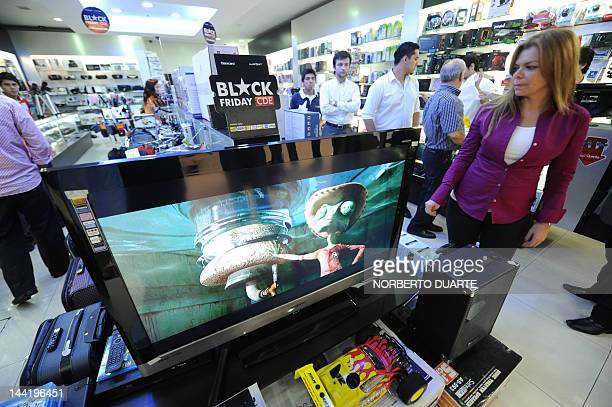 Ciudad del Este mayor Sandra Zacarias purchases an LCD TV on May 11 2012 in Ciudad del Este Paraguay Thousands of consumers are queuing up at several...