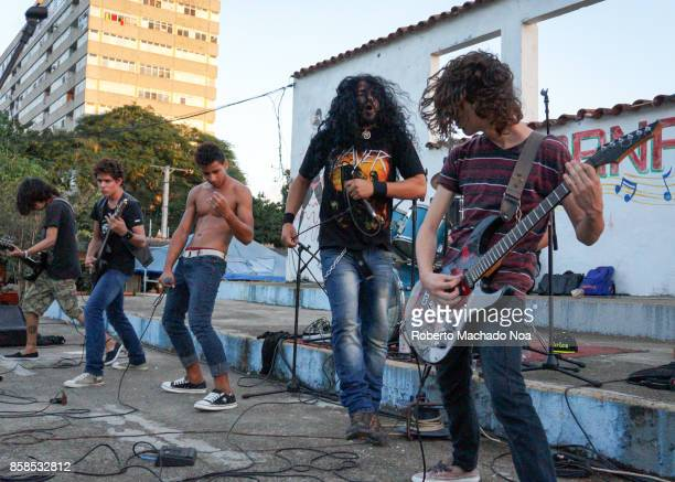 Ciudad Metal' or City of Metal' rock festival. Five band members performing alfresco with a bare-chested singer. Rock is not common in the island so...