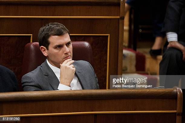 Ciudadanos party leader Albert Rivera listens the speech of Spanish Socialist Party leader Pedro Sanchez during a debate to form a new government at...