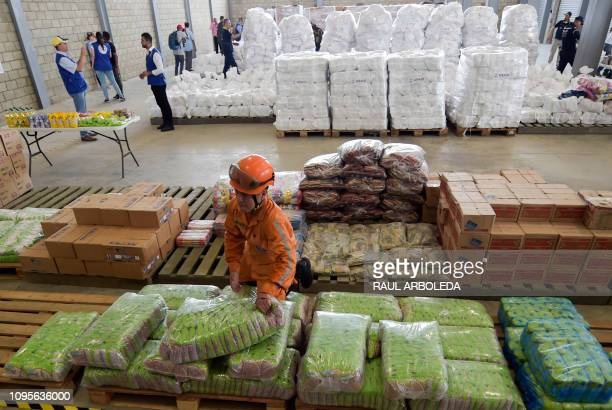A civbil defense officer arranges US humanitarian aid goods in Cucuta Colombia on the border with Tachira Venezuela on February 8 2019 Venezuelan...
