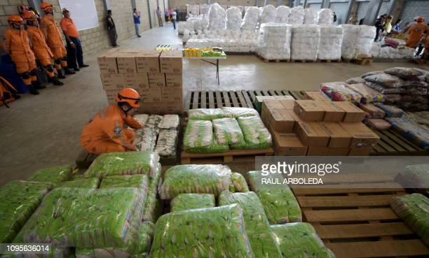 A civbil defense officer arranges US humanitarian aid goods in Cucuta Colombia on the border with Tachira Venezuela on February 8 2019 Venezuelan...
