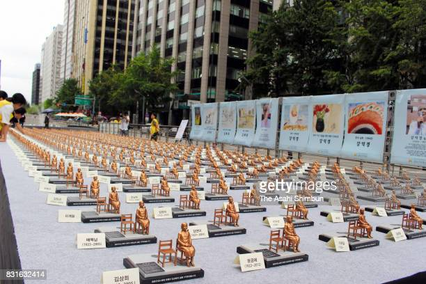 """Civic groups display 500 miniature seated statues of a girl representing """"comfort women"""" in Cheonggye Stream Square on August 14, 2017 in Seoul,..."""
