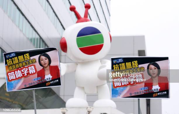 Civic Party and Neo Democrats stage a protest against the simplified Chinese subtitles appear on Television Broadcasts Limited Mandarin TVB news...