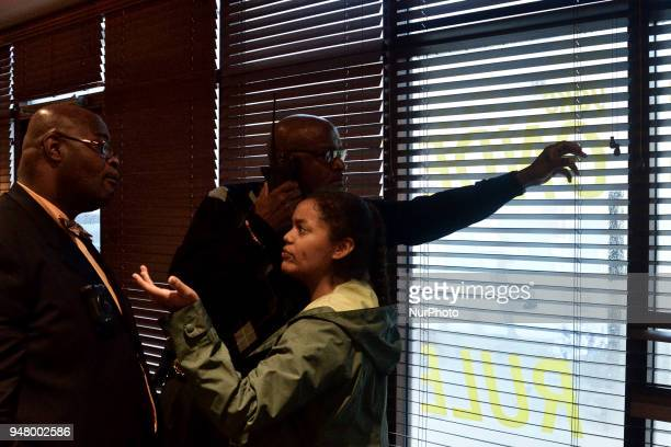 Civil Affairs officer shots the blinds after a unidentified protestor opened them inside the Starbucks on 18th and Spruce on April 16 2018