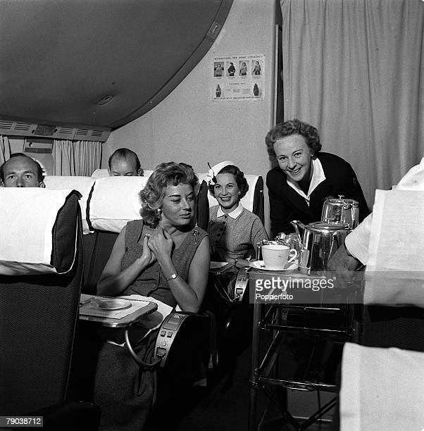 Civil Aviation Air hostess Irene Mallory is pictured serving food to the passengers on her trolley