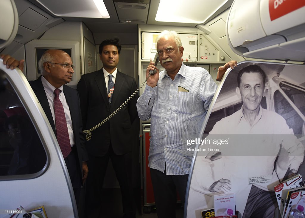 Civil Aviation Minister Ashok Gajapathi Raju speaks on air as Chief Executive Air Asia Mittu Chandilya and AirAsia India chairman S Ramadorai looks...