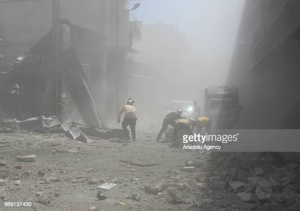 Civil defence crews and locals conduct search and rescue works after airstrikes hit residential areas of Jisr alShughur in the northwestern Idlib...