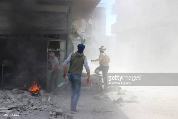 Civil defence crews and locals extinguish a fire that broke out after airstrikes hit residential areas of Jisr alShughur in the northwestern Idlib...