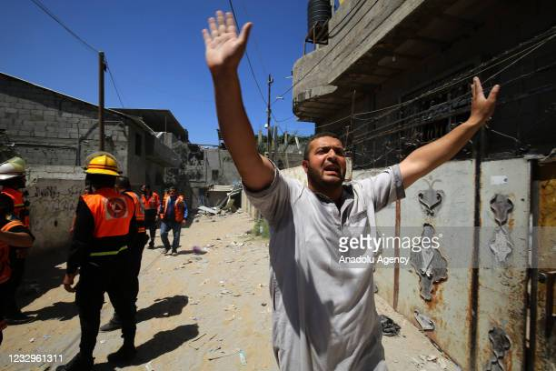 Civil defence members carry out search and rescue works at debris of a building after Israeli army carried out attacks over buildings in Rafah, Gaza...