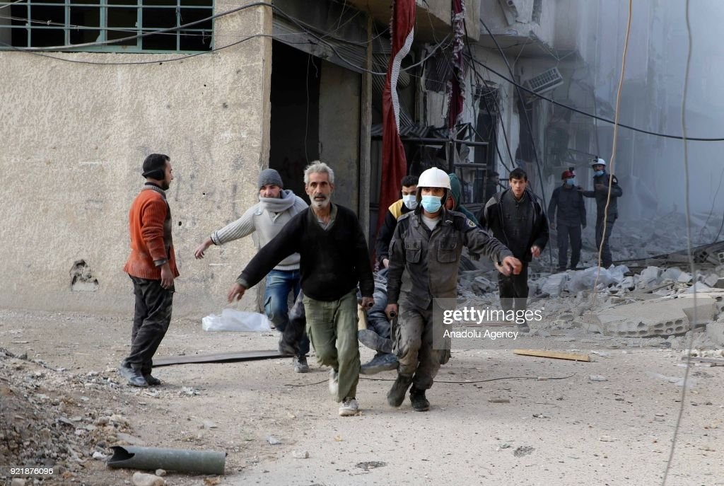 Civil defense crews and locals conduct search and rescue works after Assad Regime forces carried out airstrikes over Arbin town of the Eastern Ghouta region, which is a de-escalation zone of Damascus in Syria on February 20, 2018.