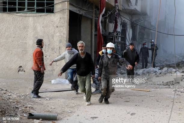 Civil defense crews and locals conduct search and rescue works after Assad Regime forces carried out airstrikes over Arbin town of the Eastern Ghouta...