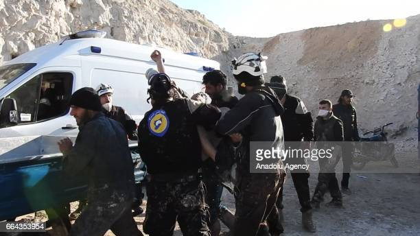 Civil defense members carry out search and rescue works after a suspected chlorine gas attack by Assad Regime forces to Khan Shaykhun town of Idlib...