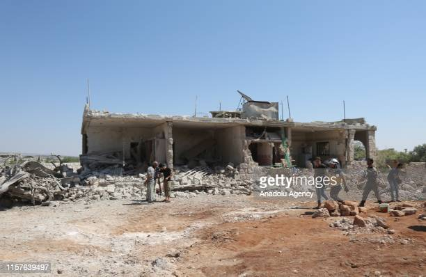 Civil defense members carry out search and rescue works at the site after airstrike hit the Kafar Roma district of Idlib Syria on July 25 2019