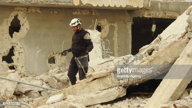 Civil defense members conduct a search and rescue operation inside the debris of Abu Ubaidah ibn alJarrah Mosque after Assad regime's airstrike in...