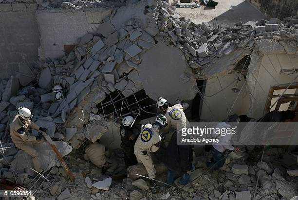 Civil defense members try to rescue victims from the wreckage after Russian airstrikes targeted residential areas at Sahur neighborhood in Aleppo...