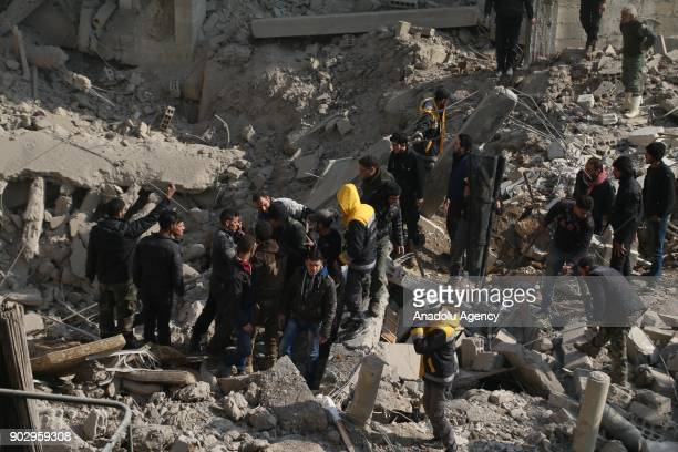 Civil defense team members carry out a search and rescue operation at the debris of a building after warplanes belonging to Assad Regime carried out...