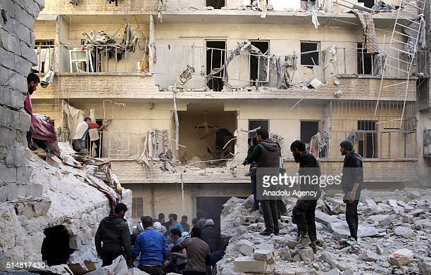 Civil defense team members try to rescue people from a wreckage of a building after war crafts belonging to the Russian army carried out airstrikes...