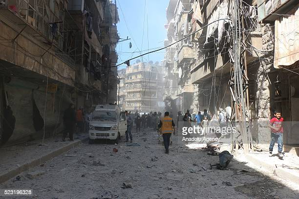 Civil defense workers and civilians work at the site after Russian forces staged airstrike over residential areas in Bustan al Qasr Neighborhood of...