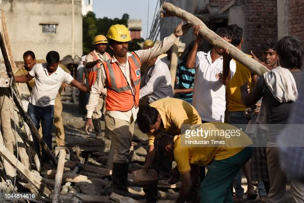 Civil Defense workers during a rescue operation after a portion of an underconstruction building collapsed in Swaroop Nagar on October 1 2018 in New...