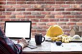 civil engineer helmet and laptop