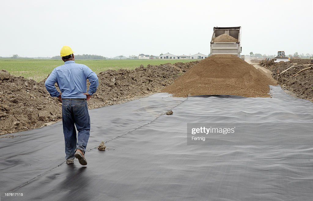Civil Engineer On A Road Construction Site With Geotextile
