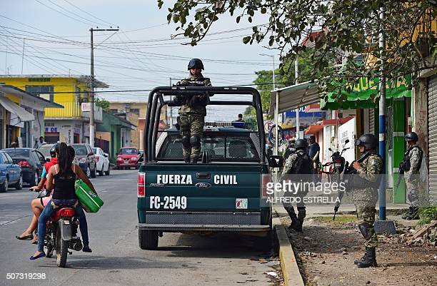 Civil Forces police patrol in Tierra Blanca community Veracruz State Mexico on January 25 2016 The parents of five youngsters who were taken by...
