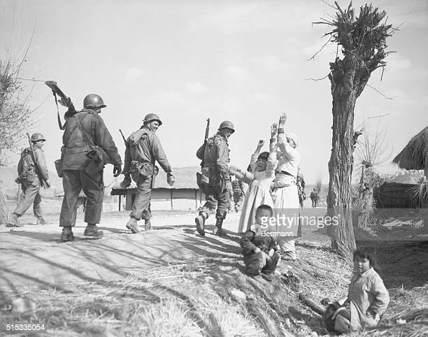 Civil Greetings Chunchon South Korea Korean women and children shout a joyous welcome as 1st cavalry GI's move into the outskirts of Chunchon a city...