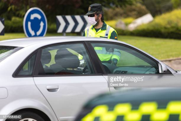 Civil Guard officer checks the documents of a driver on April 18, 2020 in Madrid, Spain. Spain is beginning to reduce strict lockdown measures to...