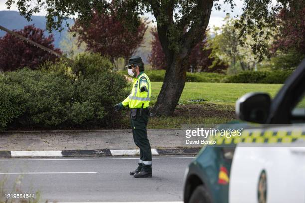 Civil Guard officer performs a check to cars on April 18, 2020 in Madrid, Spain. Spain is beginning to reduce strict lockdown measures to ease its...