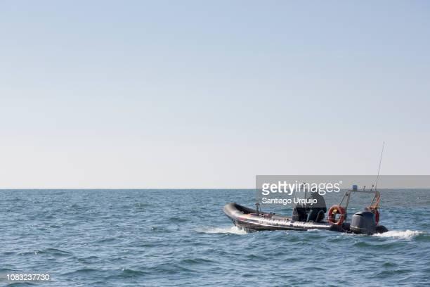 civil guard patrolling along the coast in front of santander - guardia civil fotografías e imágenes de stock