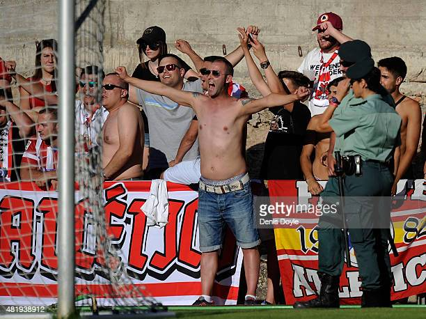 Civil Guards keep an eye on Frente Atletico Ultra fans during the Jesus Gil y Gil Memorial preseason friendly match between Numancia and Club...