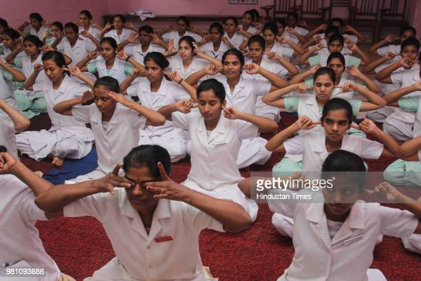 Students of Abhinav English Medium School Ambegaon perform Yoga in the school premise on the occasion of World Yoga day on June 21 2018 in Pune India...