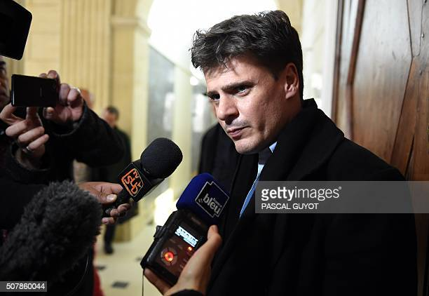 Civil party lawyer David Metaxas speaks to journalists at the start of the appeal trial of a man sentenced to thirty years of imprisonment on October...