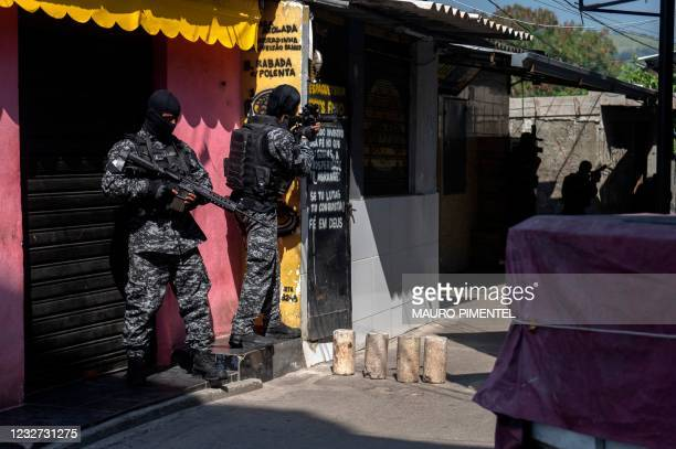 Civil Police officers take part in an operation against alleged drug traffickers at the Jacarezinho favela in Rio de Janeiro, Brazil, on May 06,...