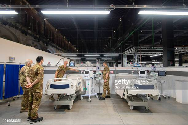 Civil Protection members work at the new COVID19 Hospital at the OGR Officine Grandi Riparazioni on April 18 2020 in Turin Italy There have been over...
