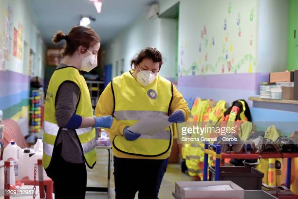 Civil Protection Volunteers at Roma Sud headquarters collect basic necessities and food to distribute to people in economic difficulty on April 04...