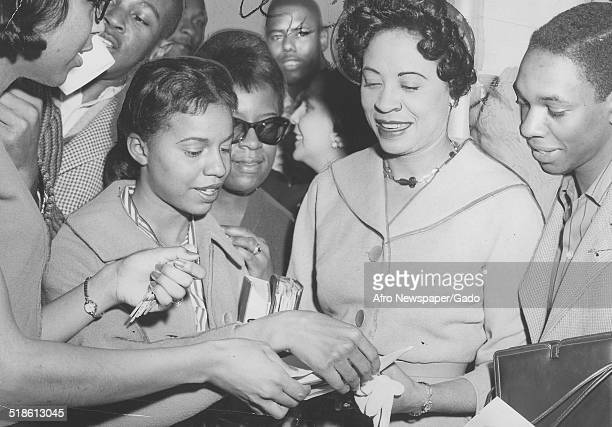 Civil Rights activist Daisy Bates signing autographs Baltimore Maryland April 11 1959