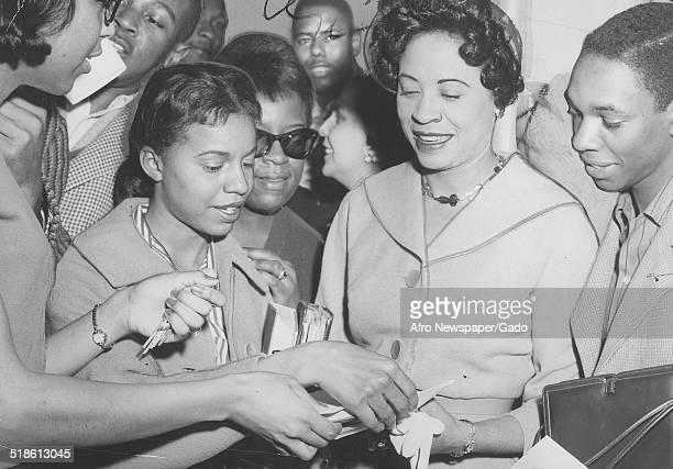 Civil Rights activist Daisy Bates signing autographs, Baltimore, Maryland, April 11, 1959.