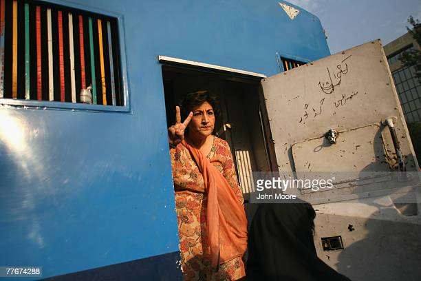 A civil rights activist is arrested at an antigovernment protest on November 4 2007 in Islamabad Pakistan A small group of protesters held signs and...