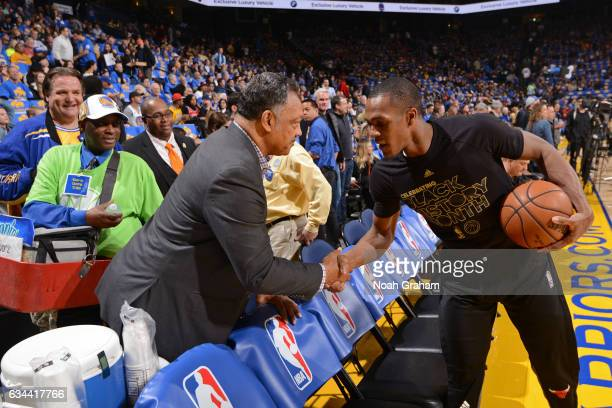Civil rights activist Jesse Jackson shakes hands with Rajon Rondo of the Chicago Bulls before the game against the Golden State Warriors on February...
